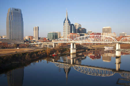Nashville Skyline and the Cumberland River with Shelby Street Bridge in Nashville, TN Stock Photo
