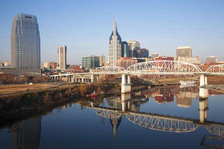 tn: Nashville Skyline and the Cumberland River with Shelby Street Bridge in Nashville, TN Stock Photo