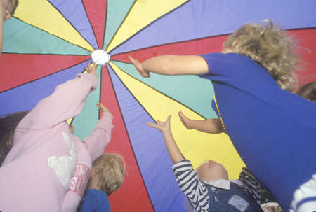 Preschool children playing a parachute game, Washington D.C. Editorial