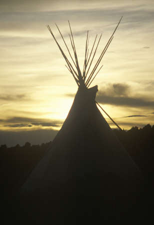 nm: Teepee silhouetted at dusk in Taos, NM