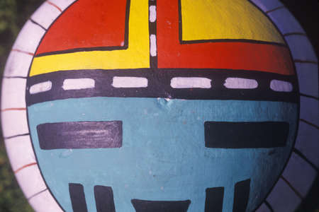 cultural artifacts: Hand painted Hopi instrument  in tight close-up in Taos, NM Editorial