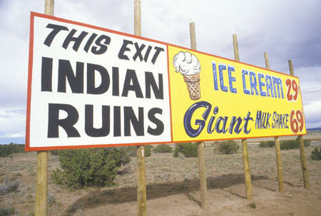 advertise with us: Indian Ruins billboard next to Ice Cream and Milkshake advertisement in NM