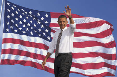 President of the United States, Barack Obama waving with background of flag of the United States of America