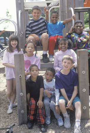 ethnically diverse: Ethnically diverse group of children in a city park, Chicago, IL Editorial