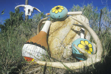 Outdoor display of colorful Hopi instruments in Taos, NM