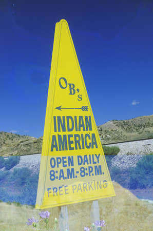 advertise with us: Triangular yellow Indian advertisement in southwestern United States