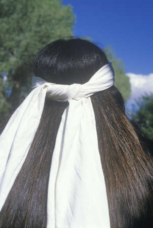 cherokee: The rear view of a white head band on a Native American Cherokee