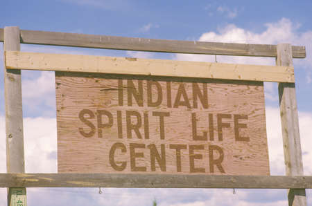 advertise with us: Wooden sign reads Indian Spirit Life Center in Southwestern United States