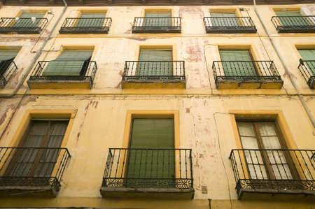 window shades: Green window shades of building in Avila Spain, an old Castilian Spanish village