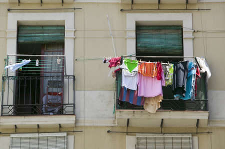 old section: Laundry hangs in window of old section of Barcelona, Spain Editorial