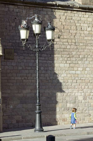 Little girl in Barcelona in Barri Gotic area, the Gothic Quarter, Spain
