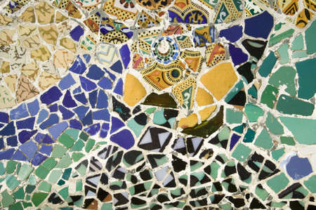 Closeup of mosaic of colored ceramic tile by Antoni Gaudi at his Parc Guell, Barcelona, Spain