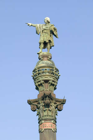 Statue of Christopher Columbus points west to New World, next to waterfront of Port Vell, Barcelona, Spain