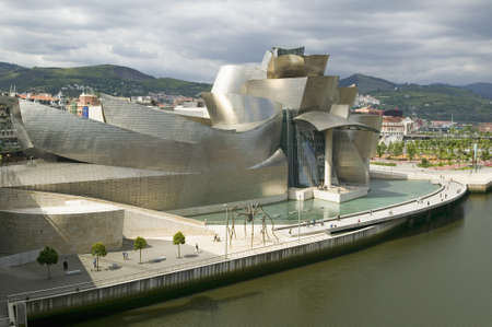 futuristic city: The Guggenheim Museum of Contemporary Art of Bilbao (Bilbo), located on the North Coast of Spain in the Basque region. Nicknamed The Hole, this is a contemporary museum built of titanium, limestone and glass and was designed by Canadian citizen, Frank O Editorial