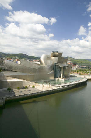 bilbo: The Guggenheim Museum of Contemporary Art of Bilbao (Bilbo) on the river Ibaizabal, located on the North Coast of Spain in the Basque region. Nicknamed The Hole, this is a contemporary museum built of titanium, limestone and glass and was designed by Ca Editorial