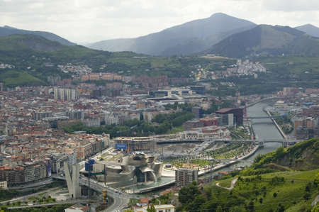bilbo: Aerial view of the Guggenheim Museum of Contemporary Art of Bilbao (Bilbo) located on the North Coast of Spain in the Basque region. Nicknamed The Hole, this is a contemporary museum built of titanium, limestone and glass and was designed by Canadian ci