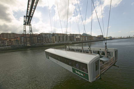 alberto: Near Bilbao, the Puente Colgante de Bizcaia, Biscay hanging or transporter bridge, connecting Portugalete on the left bank of the River IbaizabalNervi—n and Getxo on the right.