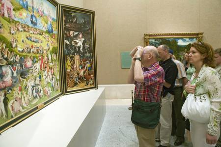 Man photographs The Garden of Earthly Delights by Hieronymus Bosch, in the Museum de Prado, Prado Museum, Madrid, Spain