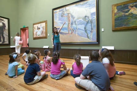 sorolla: Children have lesson on paintings by Joaqu'n Sorolla y Bastida (1863-1923) as seen in The Sorolla Museum, Madrid, Spain