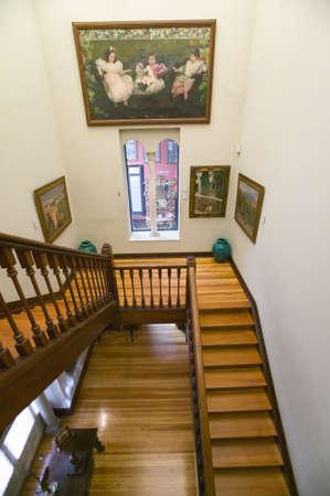 sorolla: Stairway to paintings by Joaqu'n Sorolla y Bastida (1863-1923) as seen in The Sorolla Museum, Madrid, Spain