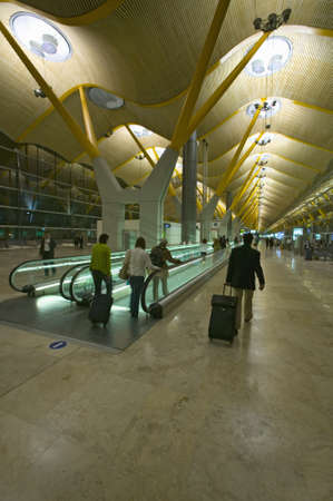 barajas: Travelers on moving sidewalk at Madrid Barajas Airport (MAD), Spains busiest airport
