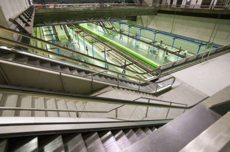 Escalators, stairs and moving sidewalk at Madrid Barajas Airport (MAD), Spains busiest airport