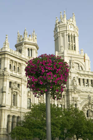 faade: Flowers and Madrid Post Office, Madrid, Spain Editorial