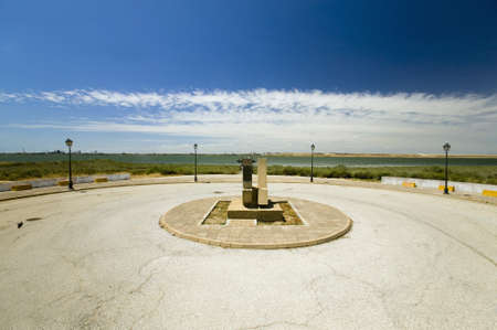 A Monument marking the precise spot where Christopher Columbus' fleet of three ships departed the harbour of Palos de la Frontera on 3 August 1492, with the Rio Tinto River and the opposite bank of the city of Huelva in the background, Southern Spain Editorial