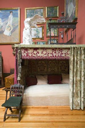 sorolla: Antique bed and paintings by Joaqu'n Sorolla y Bastida (1863-1923) as seen in The Sorolla Museum, Madrid, Spain