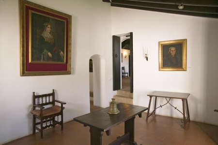 queen isabella: Interior room with paintings of Christopher Columbus and his sponsor, Spanish Queen Isabella, as seen at the 15th-century Franciscan Monasterio de Santa Mar�a de la R�bida, Palos de la Frontera, the Huelva Provence of Andalucia and Southern Spain, the sit