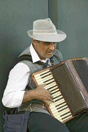 spaniards: Male accordion player in town center of Sevilla, Andalucia, Southern Spain Editorial