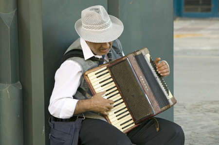 Male accordion player in town center of Sevilla, Andalucia, Southern Spain Editorial