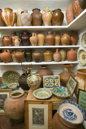 Pottery store shows stacks of old pots in old part of Centro, Sevilla Spain