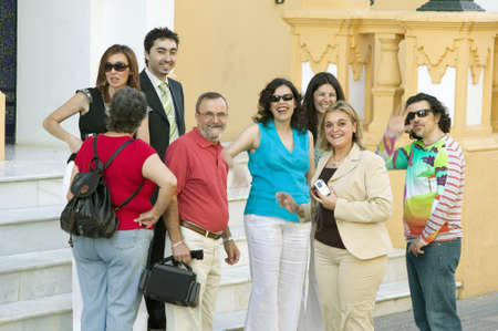 spaniards: Group of smiling people near front of church in village of Southern Spain off highway A49 west of Sevilla Editorial