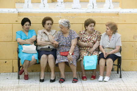spaniards: Older women sit on bench in village of Southern Spain off highway A49 west of Sevilla