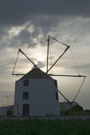 environmentalism: Ancient windmill in Portugal at sunset