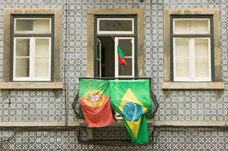Portuguese and Brazilian flags are displayed from apartment balcony in Lisboa, Lisbon, Portugal, in support of World Cup Soccer