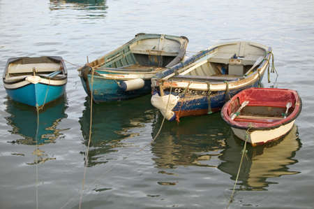 Colorful boats at sunset in Cascais, the popular seaport north of LisbonLisboa Portugal
