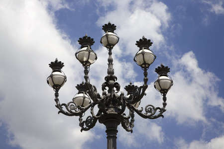 cultural artifacts: Lamppost at St Peters Square and St Peters Basilica at Vatican City, center of Catholic Church, Rome, Italy, Europe