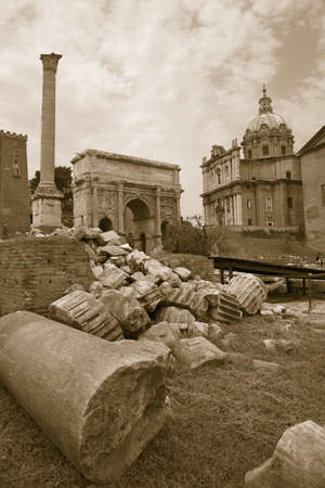 severus: Sepia image of Roman ruins with Column of Foca with Roman Forum in background in Rome, Italy, Europe Editorial