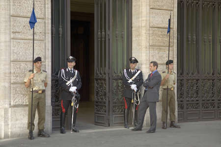 Officials and guards standing outside government building, Rome, Italy, Europe