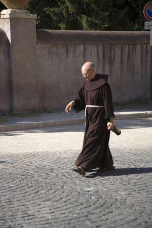 religious clothing: Priest walking near Villa dEste in Tivoli near Rome, Italy, Europe