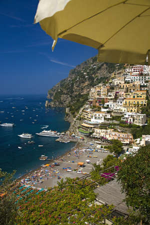 tyrrhenian: Yellow umbrella with sea view of Amalfi, a town in the province of Salerno, in the region of Campania, Italy, on the Gulf of Salerno, 24 miles southeast of Naples