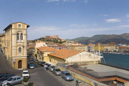 tyrrhenian: Colorful buildings and harbor of Portoferraio, Province of Livorno, on the island of Elba in the Tuscan Archipelago of Italy, Europe, where Napoleon Bonaparte was exiled in 1814 Editorial
