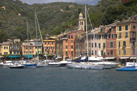 View of Portofinos Riviera di Levante and its colorful buildings and harbor, a small Italian fishing village in the province of Genoa on the Italian Riviera on the Mediterranean Sea, Italy, Europe