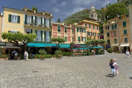 View of Portofinos Riviera di Levante and its colorful buildings and green awnings, a small Italian fishing village in the province of Genoa on the Italian Riviera on the Mediterranean Sea, Italy, Europe