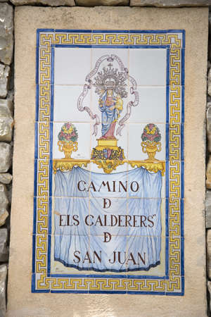 Tile sign for Camino d els Calderers d San Juan, Majorca, the largest island of Spain, Europe on the Mediterranean Sea and part of Balearic Islands archipelago Editorial