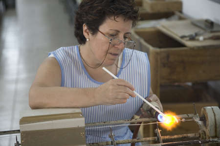 Woman working on famous pearls of Majorca, the largest island of Spain, Europe on the Mediterranean Sea and part of Balearic Islands archipelago Editorial