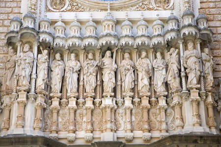 faade: Religious sculptures on the fa�ade of the basilica at the Benedictine Abbey at Montserrat, Santa Maria de Montserrat, near Barcelona, Catalonia, Spain, where some feel the Holy Grail had been