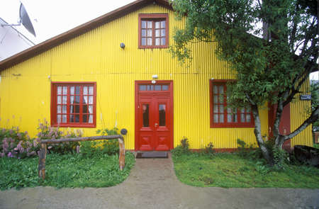 photographies: Yellow house in rural Andes Mountains, Tierra del Fuego National Park, Ushuaia, Argentina Editorial